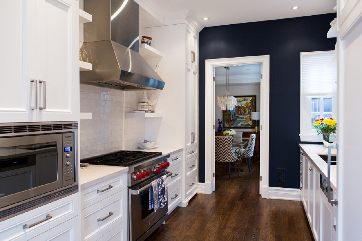 Kitchen with stainless steel appliances with navy background